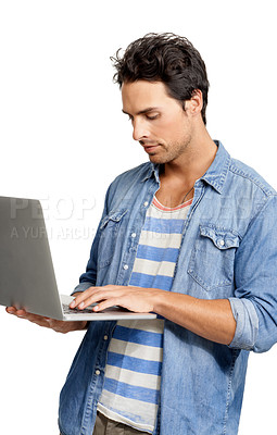 Buy stock photo A handsome young man working on his laptop against a while background