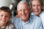 Happy senior man with grandson and daughter