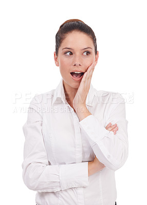 Buy stock photo Studio shot of an shocked-looking young woman standing with her hands on her face