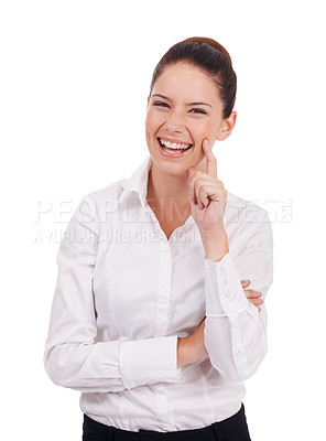 Buy stock photo Studio shot of an attractive young woman standing with her hand on her chin isolated on white