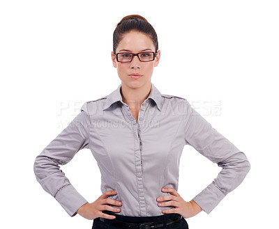 Buy stock photo Studio shot of a stern-looking young business woman with her hands on her hips isolated on white