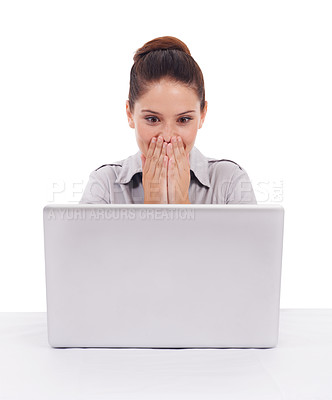 Buy stock photo Shot of a surprised-looking young woman seated in front of a laptop isolated on white