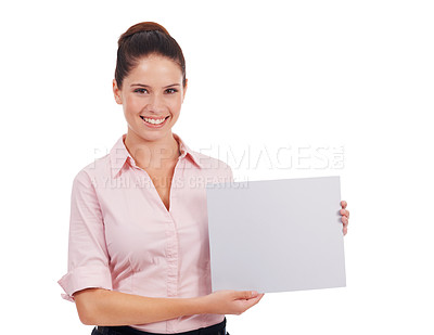 Buy stock photo Studio portrait of a young woman holding up a blank sign isolated on white