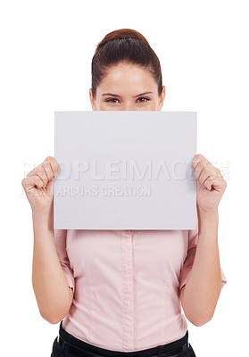 Buy stock photo Studio shot of a young women holding up a small blank placard in front of her face isolated on white