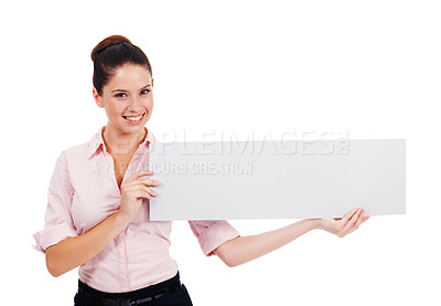 Buy stock photo Shot of an attractive young women holding up a blank banner isolated on white