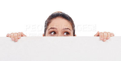 Buy stock photo Studio shot of a young women peering over a bank placard isolated on white