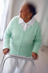 Blurred image of an elderly woman on a walker