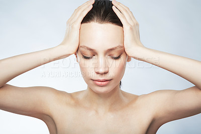 Buy stock photo Cropped image of a beautiful young woman in the nude with hands on her head and eyes closed