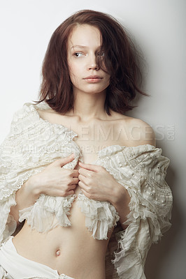 Buy stock photo A beautiful young woman semi-clad with a lace shawl wrapped around her