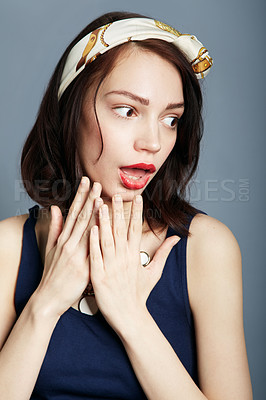 Buy stock photo A beautiful young woman posing with hands to her chin and a shocked expression on her face