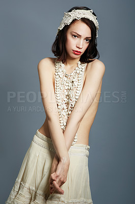 Buy stock photo Portrait of a beautiful young woman posing semi-clad in vintage clothing