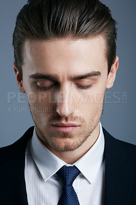 Buy stock photo Cropped shot of a handsome and fashionable young man posing in the studio