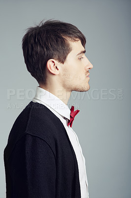 Buy stock photo Cropped shot of a handsome and stylish young man posing in the studio