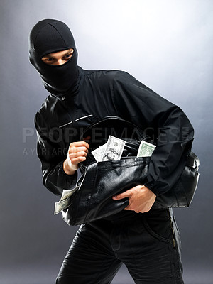 Buy stock photo Portrait of a young male robber running with bag full of money