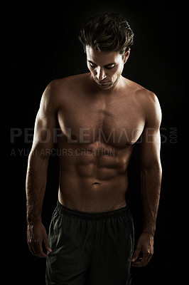 Buy stock photo Young man with a perfect physique isolated on black