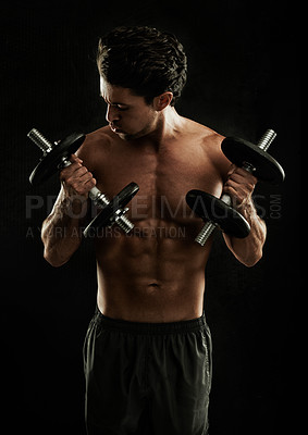 Buy stock photo Young man isolated on black performing bicep curls