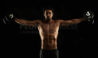Buy stock photo Muscular young man performing Lateral Raises with his dumbbells