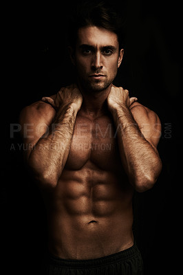 Buy stock photo Gorgeous young man with a six pack isolated on black