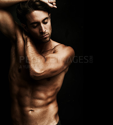 Buy stock photo Well built young man isolated on black