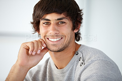 Buy stock photo Handsome young man smiling while against a white background - copyspace