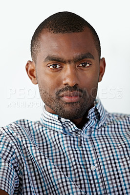 Buy stock photo Portrait of a serious African American man against a white background