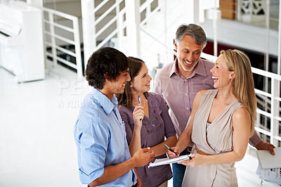 Buy stock photo A dynamic business team going over a brief together in the office