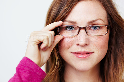 Buy stock photo Portrait of an attractive young woman weering glasses
