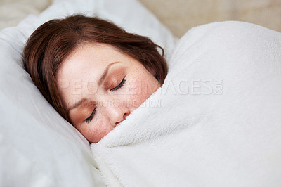 Buy stock photo An attractive young woman asleep in bed
