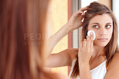 Buy stock photo A beautiful young woman cleaning her face