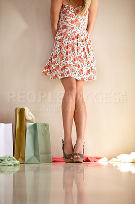 Buy stock photo Cropped shot of a woman standing against a wall surrounded by shopping bags