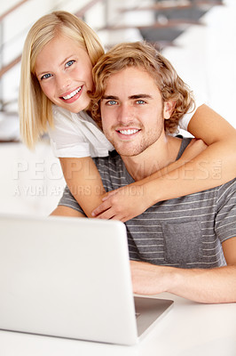 Buy stock photo Portrait of a young couple using a laptop at home