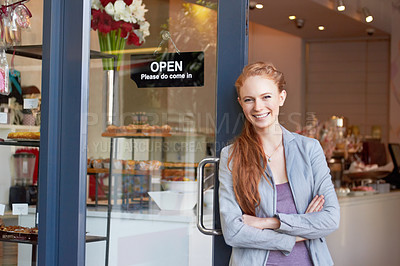 Buy stock photo Portrait of an attractive young woman standing confidently in her bakery doorway