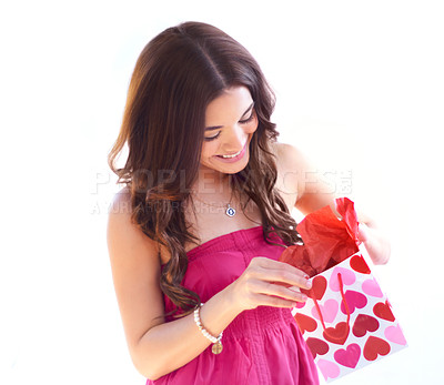 Buy stock photo An attractive young woman opening her Valentine's Day gift