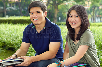 Buy stock photo Two young students sitting outside together