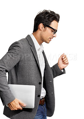 Buy stock photo Profile of a handsome young man running while carrying his tablet