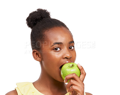Buy stock photo Studio portrait of a young african american girl eating an apple isolated on white