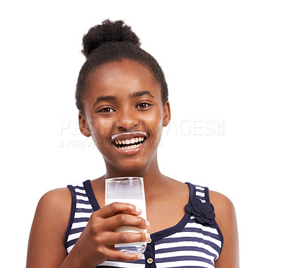 Buy stock photo Portrait of a young african american girl drinking a glass of milk isolated on white