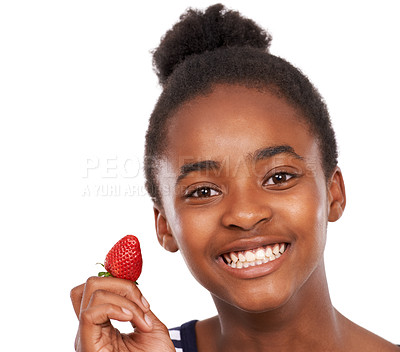 Buy stock photo Studio portrait of a happy young african american girl holding a strawberry isolated on white