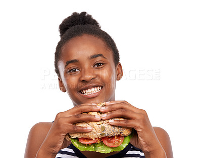 Buy stock photo Studio portrait of a happy young african american girl holding a salad sandwich isolated on white