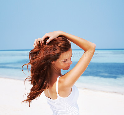 Buy stock photo Shot of a beautiful young woman at the beach