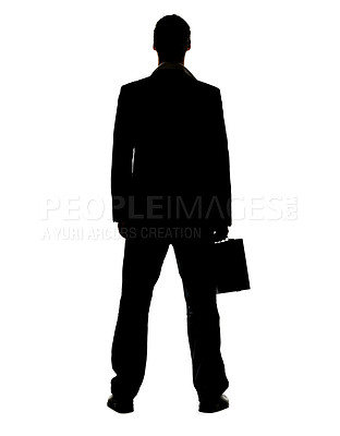 Buy stock photo Silhouette image of a young business man standing with his briefcase