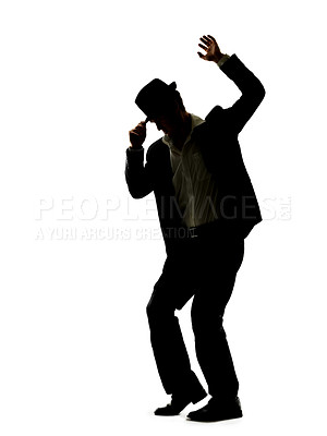 Buy stock photo Silhouette image of a young male dancer showing a dance moves over white background