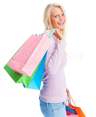 Buy stock photo Portrait of a happy young woman standing with her shopping bags isolated on white background