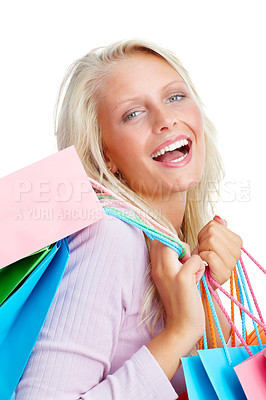 Buy stock photo Cute young female holding colorful shopping bags isolated on white