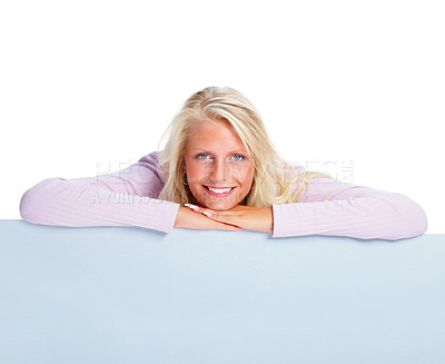 Buy stock photo Attractive happy woman smiling with an empty billboard over white background