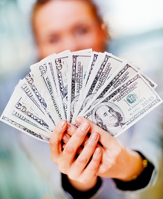 Buy stock photo Business woman holding a fan of American dollar bills, focus on the money