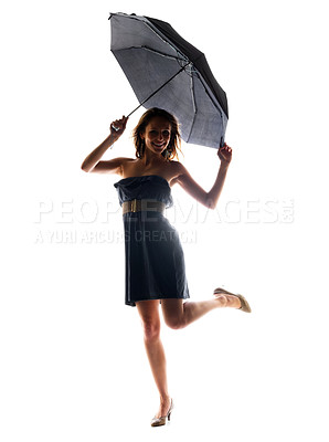 Buy stock photo Portrait of a smiling young woman standing under umbrella on isolated background