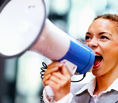 Buy stock photo Pretty young business woman yelling into a bullhorn