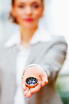 Buy stock photo Business woman holding a compass in the palm of her hand, focus on compass