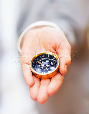 Buy stock photo Closeup of a compassed placed in the palm of a business woman's hand